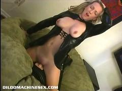 Blonde girl in latex riding a sybian