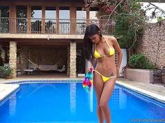 Denise Gomez posing in her yellow bikini