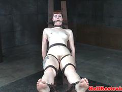 Tattooed slave bent over and dildo drilled
