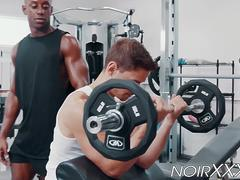 Handsome dude seduced and fucked by his muscular black trainer