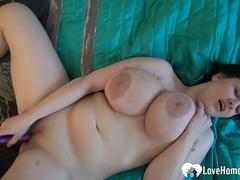 Amateur chick with huge tits uses a dildo