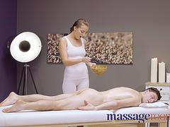 Massage Rooms Sexy pert young masseuse Katy Rose gives oily hand job