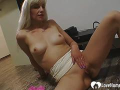 Blonde babe strips and masturbates with fingers