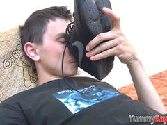 Gay dude sniffing shoe