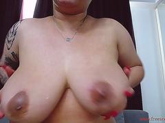 young blonde girl spits on her big and beautiful breasts