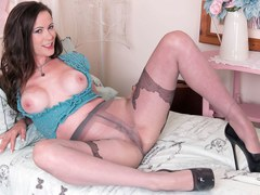 Big tits brunette Vicki Peach fucks glass dildo in fancy designer pantyhose and stilettos