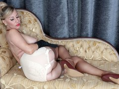 Sexy blonde Saffy fucks pussy with her heels in vintage stockings and lingerie