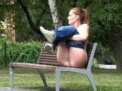Cheeky Redhead Pisses While Sitting On Bench