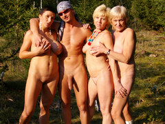 Horny mature ladies sharing a guy outdoor